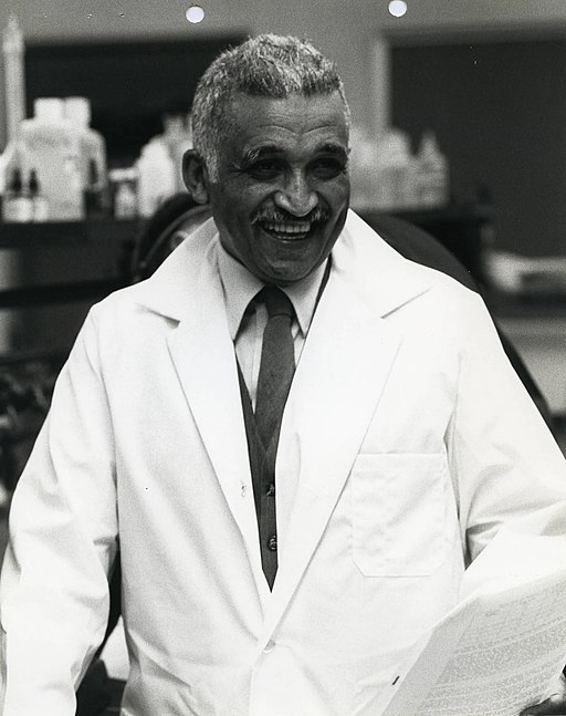 Photo of Samuel P. Massie in white lab coat