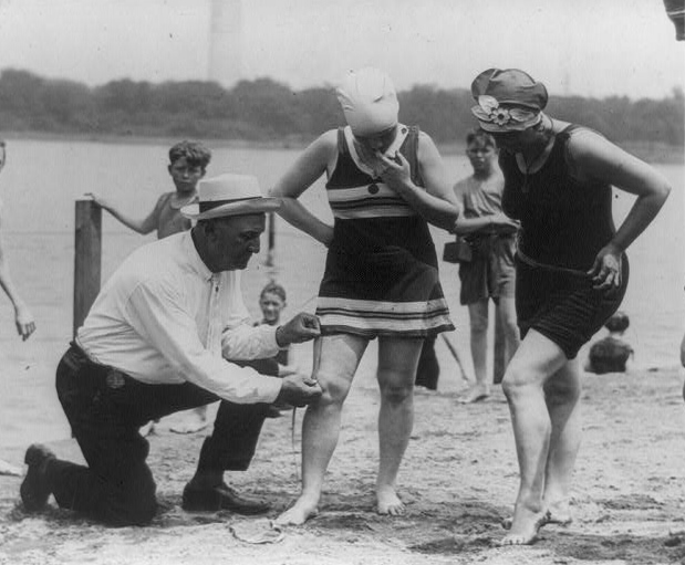 Photo of inspector and two women in above-the-knee bathing costumes